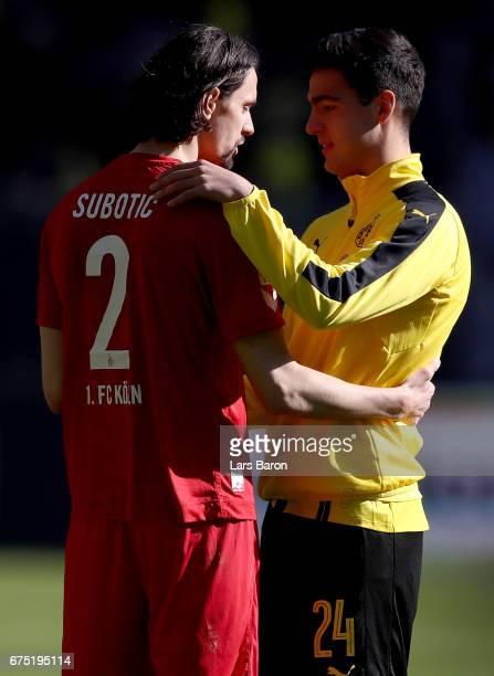 Neven Subotic of Koeln hugs Mikel Merino of Dortmund during the Bundesliga match between Borussia Dortmund and 1 FC Koeln at Signal Iduna Park on...
