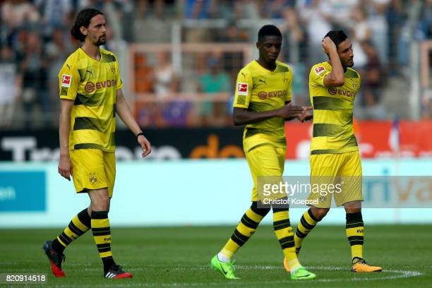 Neven Subotic Ousmane Dembele and Nuri Sahin of Dortmund look dejected after the preseason friendly match between VfL Bochum and Borussia Dortmund at...