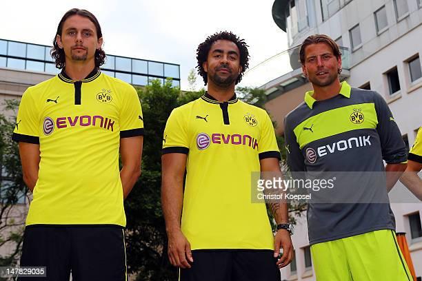Neven Subotic Patrick Owomoyela and Roman Weidenfeller prfesent the new jersey during the Borussia Dortmund Puma kit launch at Westfaelischer...