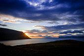 Iceland westfjords summer time reflection at sunset