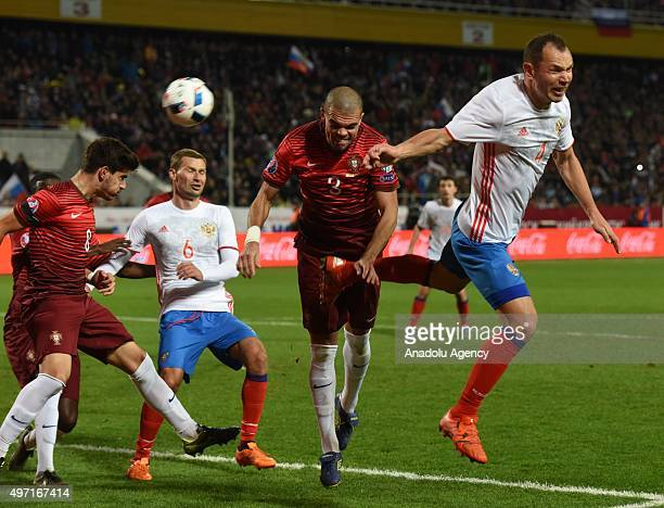 Neves Pepe of Portugal and Berezutskiy and Ignashevich of Russia contest the ball during the friendly match between Russia and Portugal at Kuban...