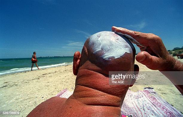 Neville Giles of Saint Kilda applying factor 30 to his head on the beach at Port Melbourne Neville is on the beach everyday if the sun is out He uses...