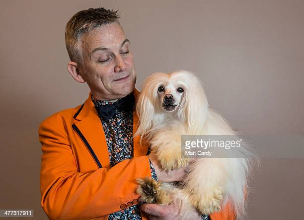 Neville Gwynne poses with his dog Enoch a Chinese Crested Powderpuff during the Toy and Utility day of the Crufts dog show at the NEC on March 8 2014...