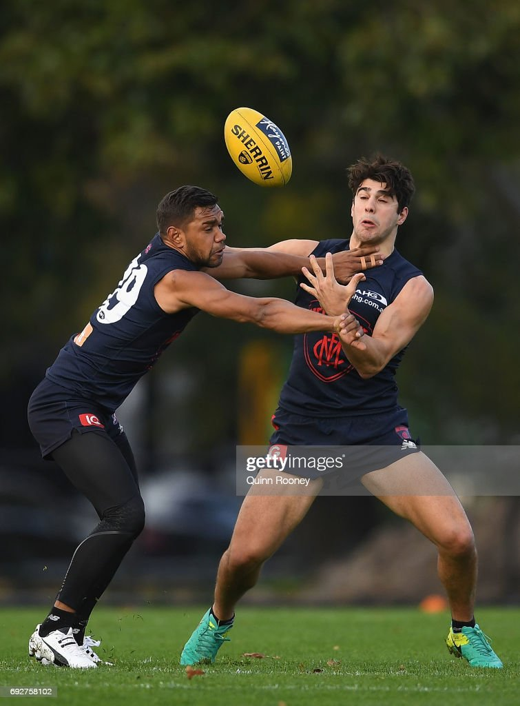 Neville Jetta and Christian Petracca of the Demons compete for a mark during a Melbourne Demons AFL training session at Gosch's Paddock on June 6, 2017 in Melbourne, Australia.