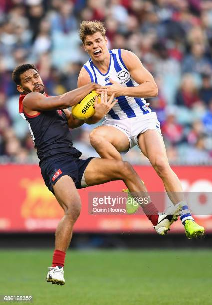 Neville Jetta of the Demons and Mason Wood of the Kangaroos compete for a mark during the round nine AFL match between the Melbourne Demons and the...