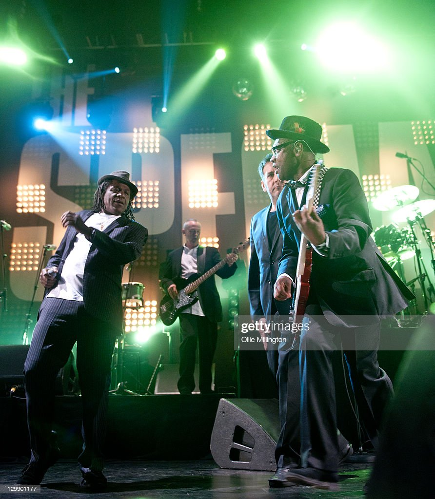 Neville Staple, Horace Panter, Terry Hall, Lynval Golding and Neville Staple of The Specials perform onstage at Nottingham Capital FM Arena on October 21, 2011 in Nottingham, United Kingdom.