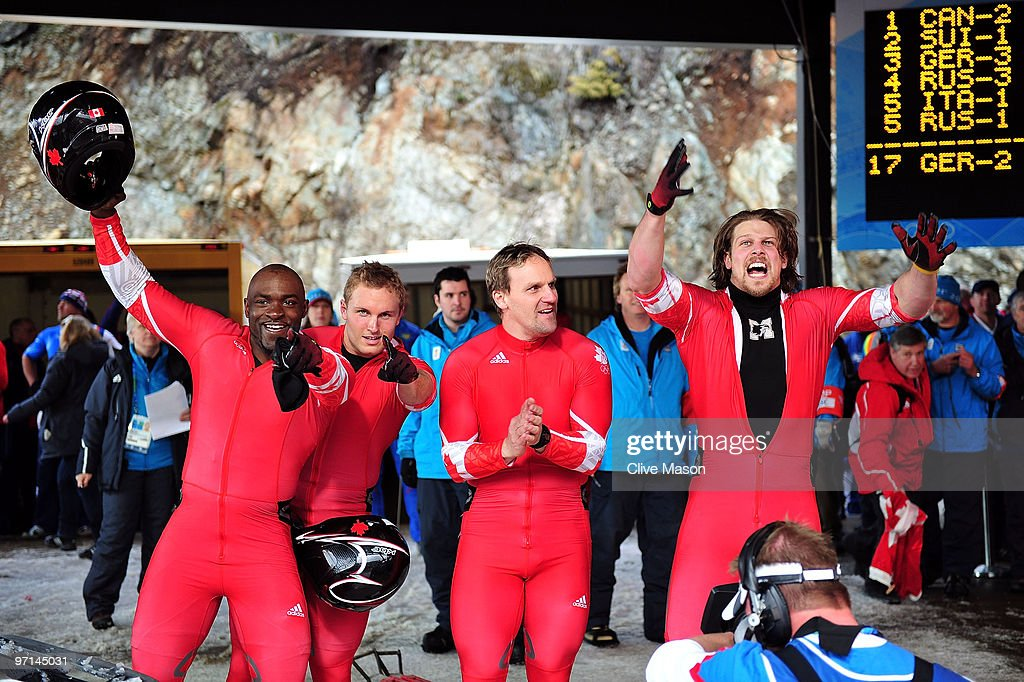 Neville Wright, Justin Kripps, <a gi-track='captionPersonalityLinkClicked' href=/galleries/search?phrase=Pierre+Lueders&family=editorial&specificpeople=211058 ng-click='$event.stopPropagation()'>Pierre Lueders</a> and Jesse Lumsden of Canada 2 celebrate after completing heat 4 during the men's four man bobsleigh on day 16 of the 2010 Vancouver Winter Olympics at the Whistler Sliding Centre on February 27, 2010 in Whistler, Canada.