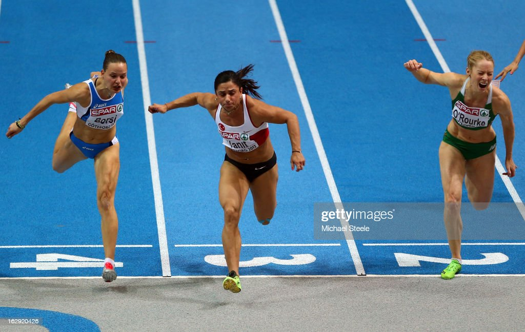 Nevin Yanit of Turkey (C) crosses the line to win gold in the Women's 60m Hurdles Final during day one of the European Athletics Indoor Championships at Scandinavium on March 1, 2013 in Gothenburg, Sweden.
