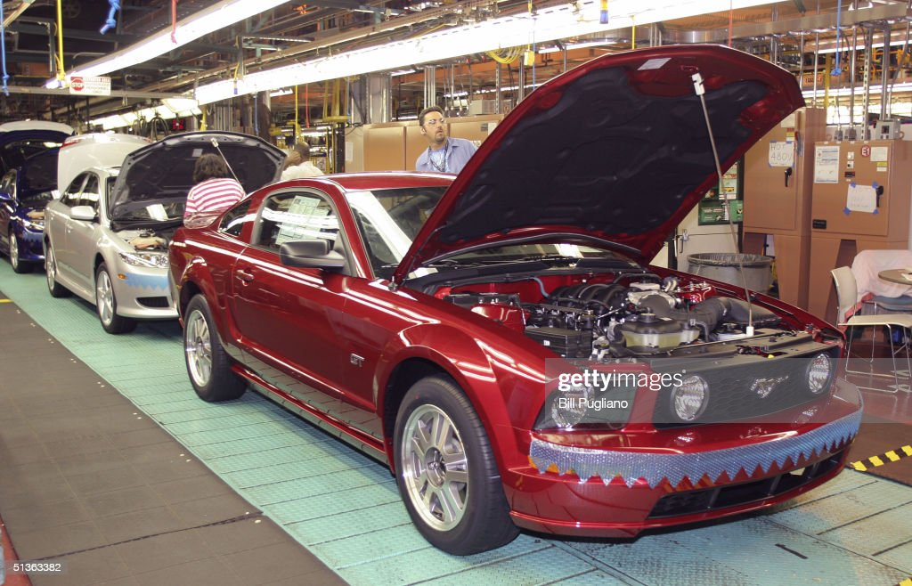 A new 2005 Ford Mustang prepares to be rolled off the line at a new plant known as Auto Alliance International September 27, 2004 in Flat Rock, Michigan. Ford Motor Company invested approximately $700 million in the new plant's flexible manufacturing system, which includes a new body shop with 380 robots. The new system enables the plant to build six new models on two vehicle platforms.