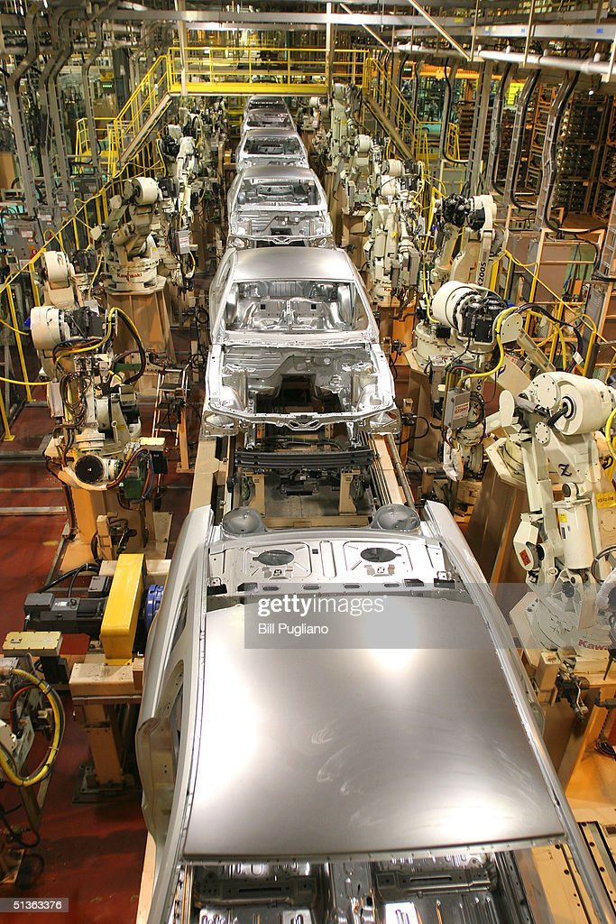 New 2005 Ford Mustangs are assembled at a new plant known as Auto Alliance International September 27, 2004 in Flat Rock, Michigan. Ford Motor Company invested approximately $700 million in the new plant's flexible manufacturing system, which includes a new body shop with 380 robots. The new system enables the plant to build six new models on two vehicle platforms.