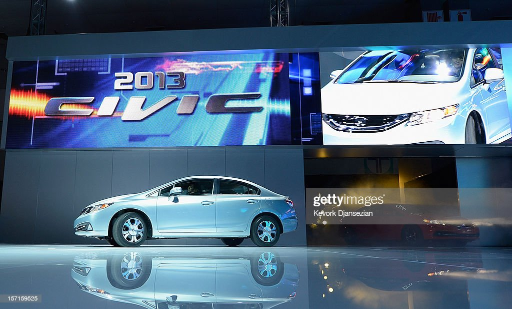 New 2013 Honda Civic cars are unveiled during the Los Angeles Auto show on November 29, 2012 in Los Angeles, California. The LA Auto Show opens to the public on November 30 and runs through December 9.