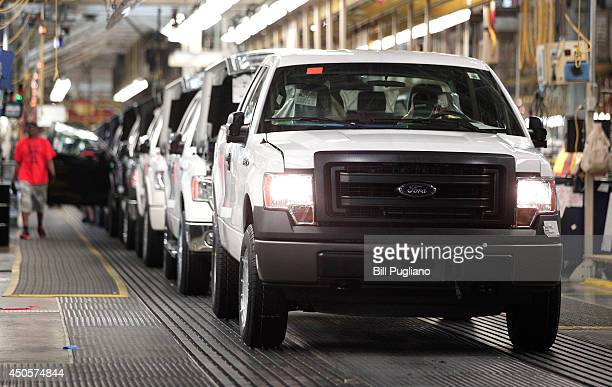 New 2014 Ford F150 trucks are prepared to come off the assembly line at the Ford Dearborn Truck Plant June 13 2014 in Dearborn Michigan Production...
