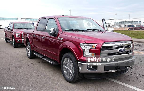 New 2015 Ford F150 trucks are driven to the lot after coming off the assembly line at the Ford Dearborn Truck Plant November 11 2014 in Dearborn...