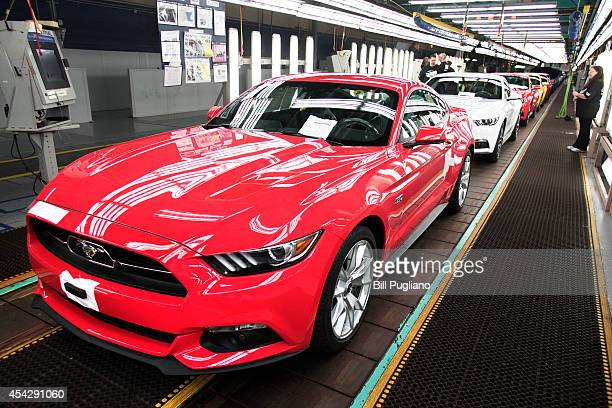 New 2015 Ford Mustangs come off the assembly line at the Ford Flat Rock Assembly Plant August 28 2014 in Flat Rock Michigan Ford's allnew Mustang...