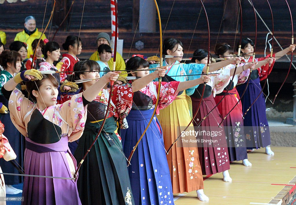 New 20-years-old wearing kimono take aim during an archery event to celebrate their coming-of-age at Sanjusangendo Temple on January 12, 2014 in Kyoto, Japan. Some 1,600 people took part in the annual event.