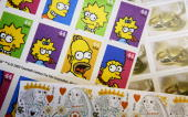 New 44 cent stamps are seen displayed on a counter May 11 2009 in San Francisco California The price of a first class postage stamp is increasing two...