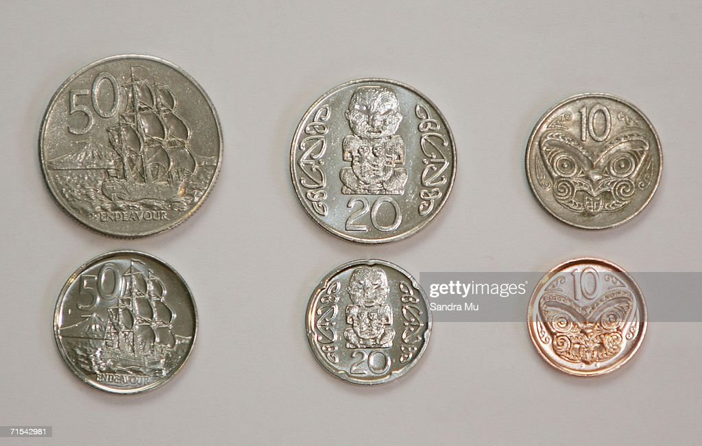 New (L-R) 50, 20 and 10 cent coins which began circulation today for the first time are shown below the old, larger coins July 31, 2006 in Auckland, New Zealand. From today the 50, 20 and 10 cent pieces will be replaced by lighter, smaller versions. The five cent piece will cease to exist after the three month changeover phase.
