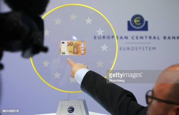 A new 50 euro currency bank note is displayed during its unveiling at the European Central Bank headquarters in Frankfurt Germany on Tuesday April 4...