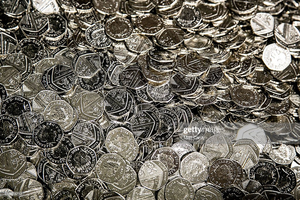 New 50p coins are seen at the Royal Mint plant on August 1 2014 in Llantrisant Wales The Royal Mint formed over 1100 years to produce coins for...