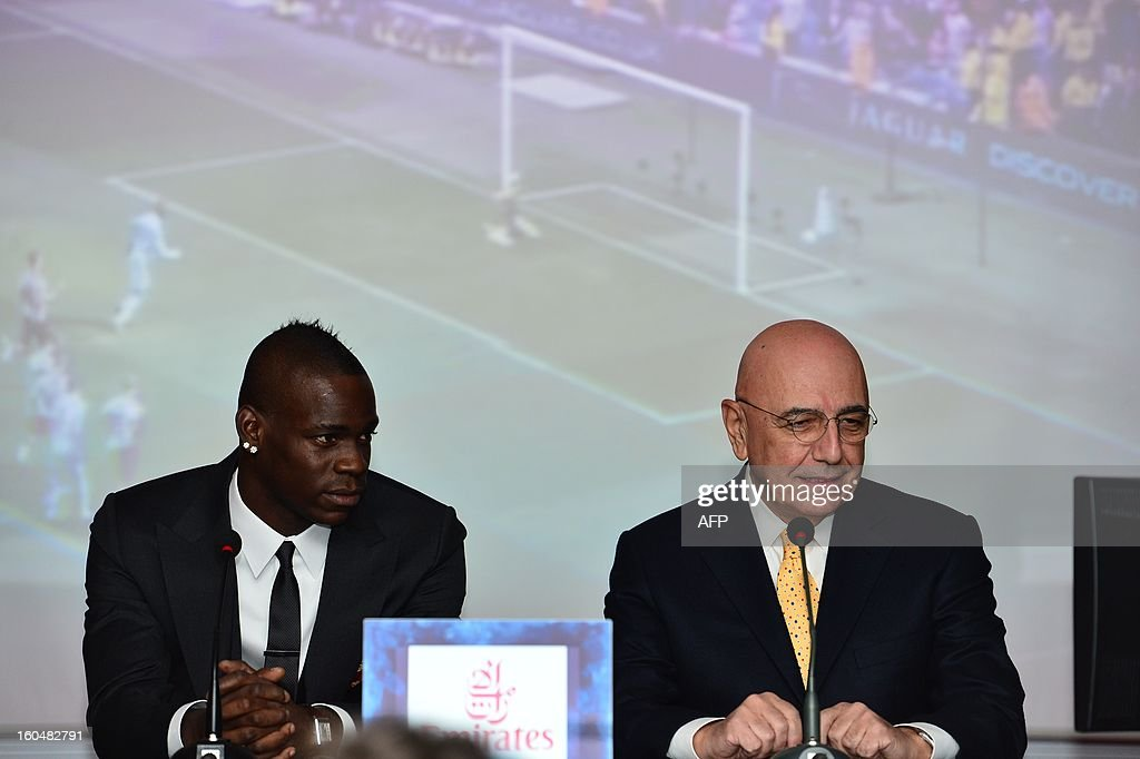 New AC Milan player, Italian striker <a gi-track='captionPersonalityLinkClicked' href=/galleries/search?phrase=Mario+Balotelli&family=editorial&specificpeople=4940446 ng-click='$event.stopPropagation()'>Mario Balotelli</a> (L) and AC Milan sporting director Adriano Galliani listen during a press conference on February 1, 2013 at San Siro Stadium in Milan.