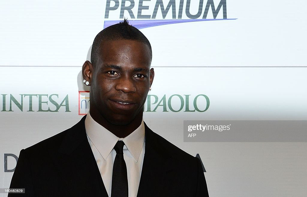 New AC Milan player, Italian striker <a gi-track='captionPersonalityLinkClicked' href=/galleries/search?phrase=Mario+Balotelli&family=editorial&specificpeople=4940446 ng-click='$event.stopPropagation()'>Mario Balotelli</a>, poses during a press conference for his presentation as a new player on February 1, 2013 at San Siro Stadium in Milan.