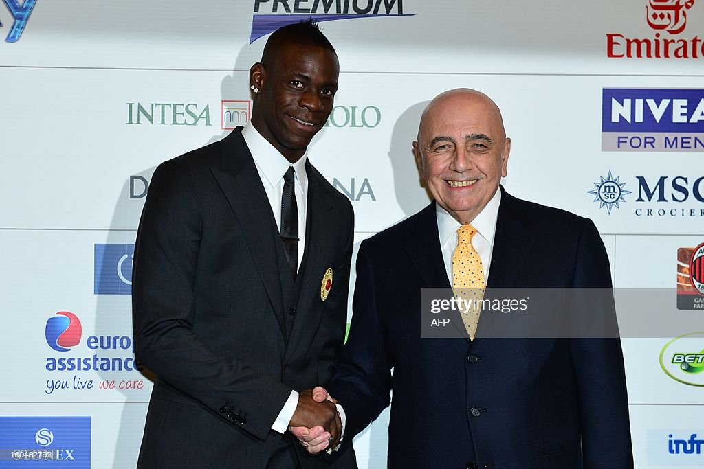 New AC Milan player, Italian striker <a gi-track='captionPersonalityLinkClicked' href=/galleries/search?phrase=Mario+Balotelli&family=editorial&specificpeople=4940446 ng-click='$event.stopPropagation()'>Mario Balotelli</a> (L) poses with AC Milan sporting director Adriano Galliani during a press conference on February 1, 2013 at San Siro Stadium in Milan.