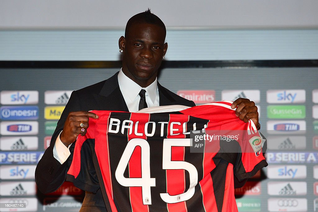 New AC Milan player, Italian striker <a gi-track='captionPersonalityLinkClicked' href=/galleries/search?phrase=Mario+Balotelli&family=editorial&specificpeople=4940446 ng-click='$event.stopPropagation()'>Mario Balotelli</a> poses with his AC Milan's team jersey prior a press conference on February 1, 2013 at San Siro Stadium in Milan. AFP PHOTO / GIUSEPPE CACACEs