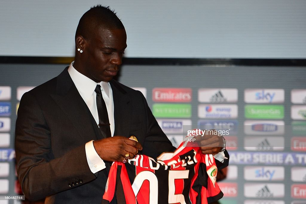 New AC Milan player, Italian striker Mario Balotelli, poses with his AC Milan's team jersey prior a press conference on February 1, 2013 at San Siro Stadium in Milan. AFP PHOTO / GIUSEPPE CACACEs