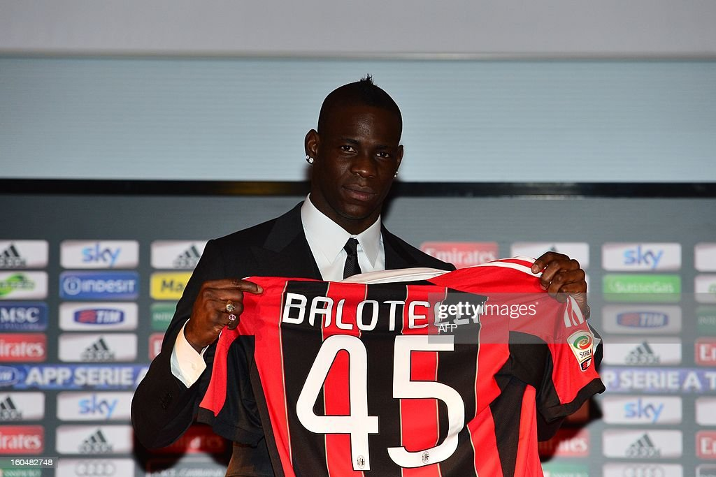 New AC Milan player, Italian striker <a gi-track='captionPersonalityLinkClicked' href=/galleries/search?phrase=Mario+Balotelli&family=editorial&specificpeople=4940446 ng-click='$event.stopPropagation()'>Mario Balotelli</a>, poses with his AC Milan's team jersey prior a press conference on February 1, 2013 at San Siro Stadium in Milan.