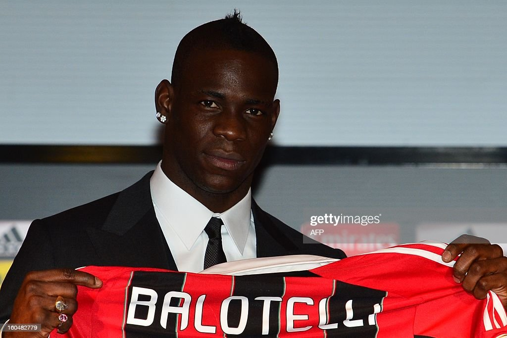New AC Milan player, Italian striker <a gi-track='captionPersonalityLinkClicked' href=/galleries/search?phrase=Mario+Balotelli&family=editorial&specificpeople=4940446 ng-click='$event.stopPropagation()'>Mario Balotelli</a>, poses with his AC Milan's team jersey prior a press conference on February 1, 2013 at San Siro Stadium in Milan. AFP PHOTO / GIUSEPPE CACACEs