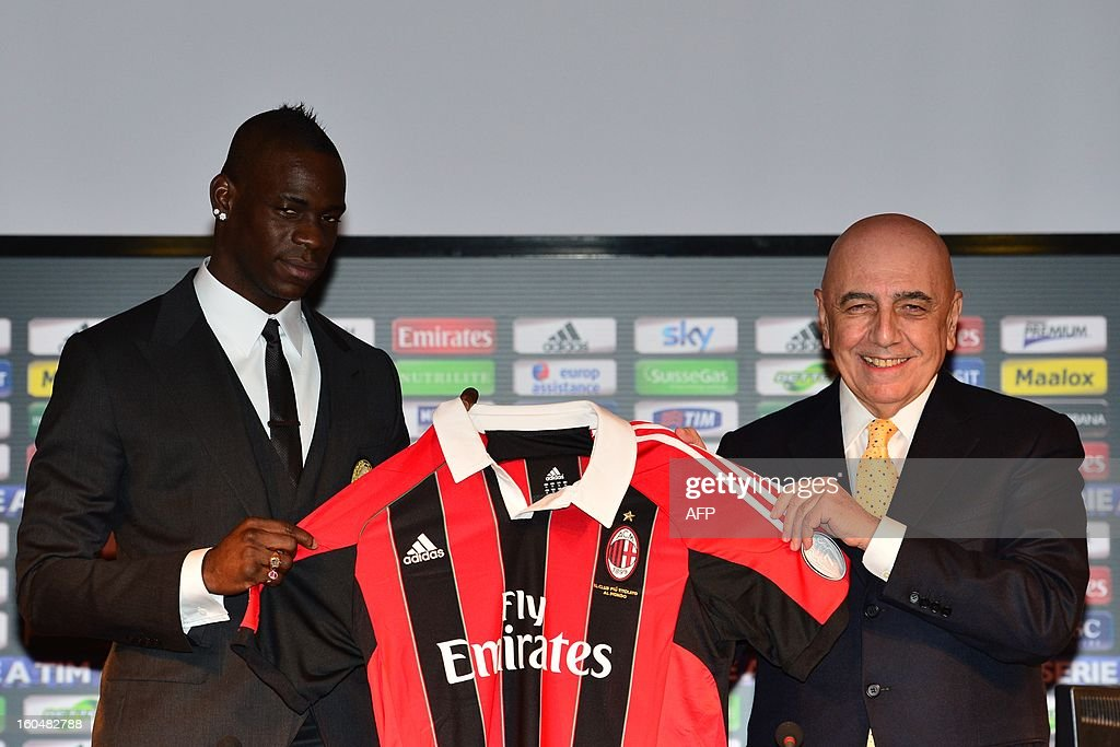 New AC Milan player, Italian striker <a gi-track='captionPersonalityLinkClicked' href=/galleries/search?phrase=Mario+Balotelli&family=editorial&specificpeople=4940446 ng-click='$event.stopPropagation()'>Mario Balotelli</a> (L) poses with his AC Milan's team jersey together with AC Milan sporting director Adriano Galliani during a press conference on February 1, 2013 at San Siro Stadium in Milan.