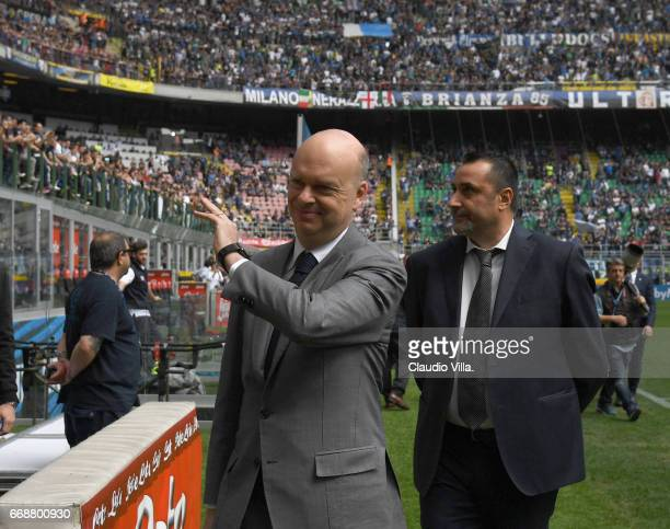 New AC Milan Sporting Director Massimo Mirabelli and new AC Milan CEO Marco Fassone look on prior to the Serie A match between FC Internazionale and...
