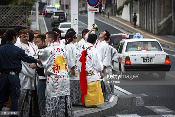 New adults drinking alchohol showing off in Kokusai dori after attending a Coming of Age Day celebration ceremony in Okinawa Japan on January 8 2017...