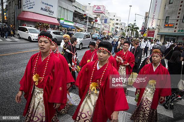 New adults in kimonos show off in Kokusai dori after attending a Coming of Age Day celebration ceremony in Okinawa Japan on January 8 2017 The Coming...