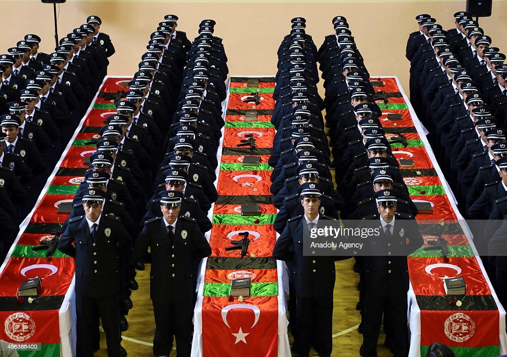 New Afghani police officers swear during a graduation ceremony at the Sivas Police Academy in Sivas eastern province of Turkey on September 30, 2014.