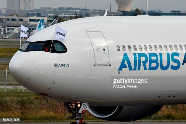 A new Airbus A330neo is pictured after landing at the end of its first flight on October 19 at the ToulouseBlagnac airport near Toulouse / AFP PHOTO...