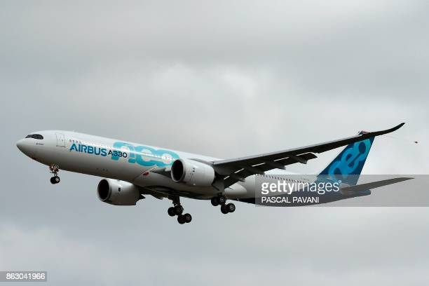 A new Airbus A330neo is pictured during its first flight on October 19 at the ToulouseBlagnac airport near Toulouse / AFP PHOTO / PASCAL PAVANI