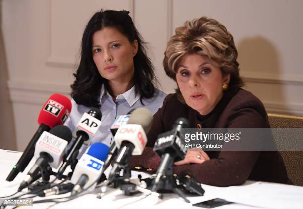 New alleged victim of film producer Harvey Weinstein actor and model Natassia Malthe listens to her Attorney Gloria Allred speaking during a press...