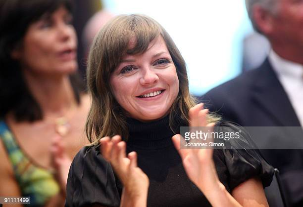 New ambassador for the Jose Carreras Leukaemia foundation Annett Louisan claps her hands during the announcement ceremony on September 24 2009 in...