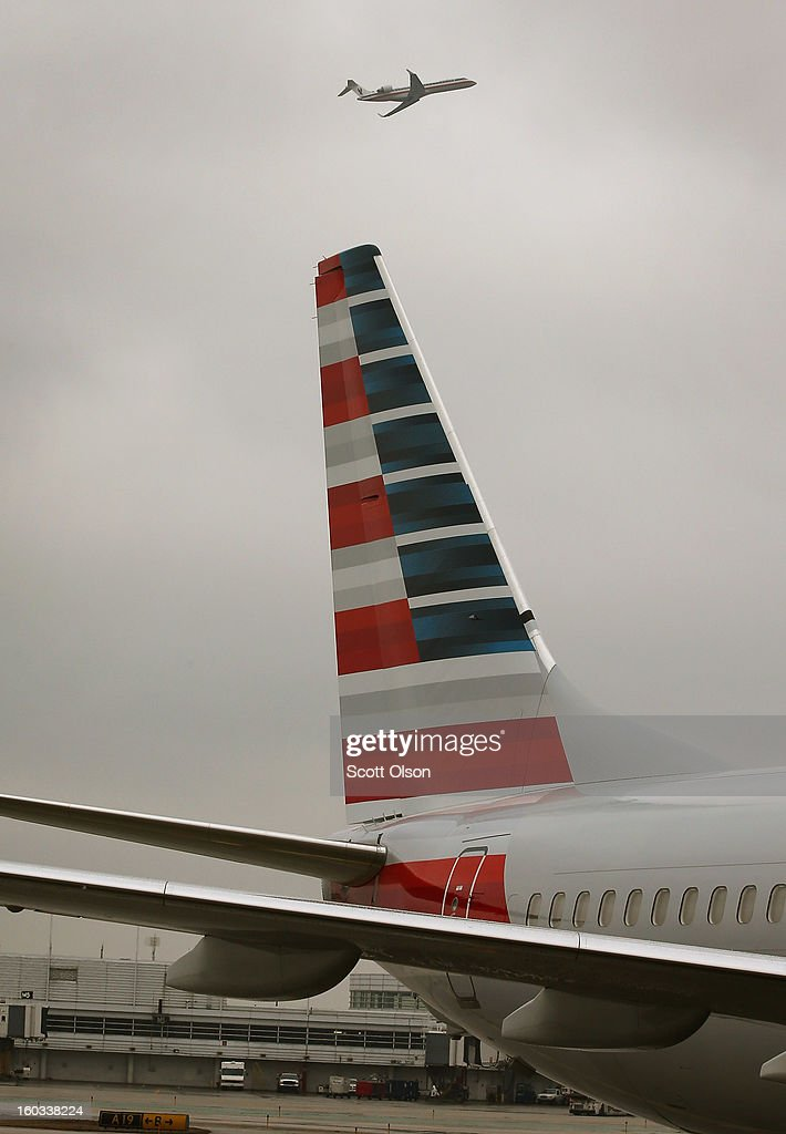 A new American Airlines 737-800 aircraft featuring a new paint job sits at a gate at O'Hare Airport on January 29, 2013 in Chicago, Illinois. This year, American plans to take delivery of nearly 60 new aircraft featuring the logo and paint. American currently has a fleet of nearly 900 aircraft that fly more than 3,500 daily flights worldwide.
