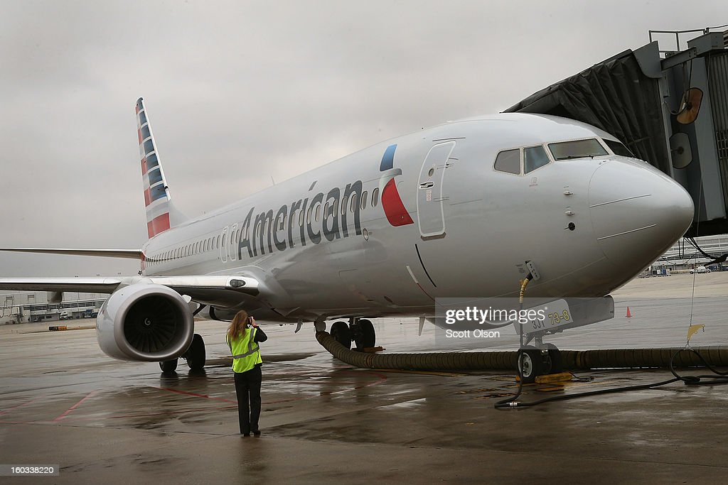 A new American Airlines 737-800 aircraft featuring a new paint job with the company's new logo sits at a gate at O'Hare Airport on January 29, 2013 in Chicago, Illinois. This year, American plans to take delivery of nearly 60 new aircraft featuring the logo and paint. American currently has a fleet of nearly 900 aircraft that fly more than 3,500 daily flights worldwide.
