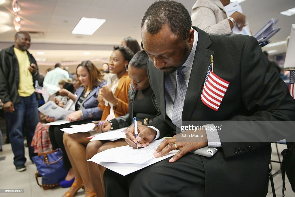 New American citizen Serge Siba Guilao from the west African country of Guinea fills out a voter registration form following a naturalization ceremony held at the U.S. Citizenship and Immigration Services (USCIS), office on May 17, 2013 in New York City. One hundred and fifty immigrants from 38 different countries became U.S. citizens at the event. Some 11 million undocumented immigrants living in the U.S. stand to eventually gain American citizenship if Congress passes immigration reforms currently under negotiation.