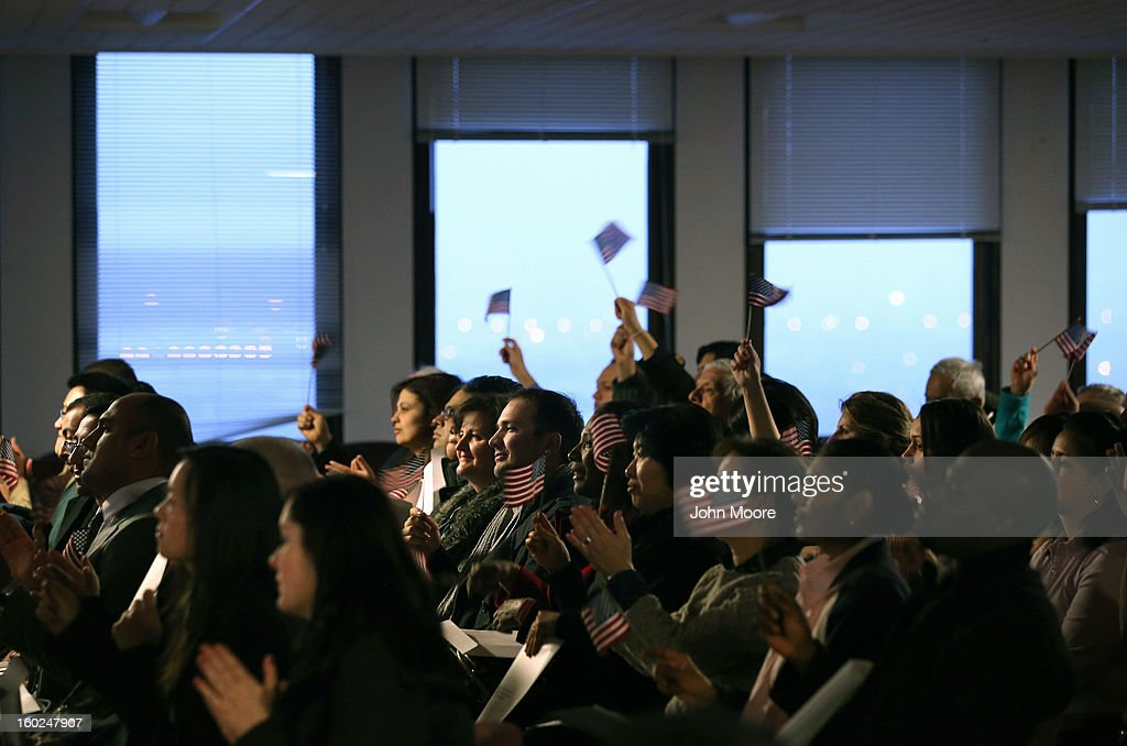 New American citizens applaud following a naturalization ceremony at the district office of U.S. Citizenship and Immigration Services (USCIS) on January 28, 2013 in Newark, New Jersey. Some 38,000 immigrants became U.S. citizens at the Newark office alone in 2012.