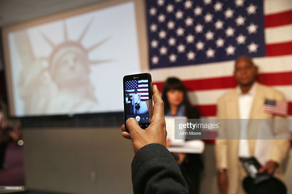 New American citizens pose for photos following a naturalization ceremony at the U.S. Citizenship and Immigration Services (USCIS), office on May 17, 2013 in New York City. One hundred and fifty immigrants from 38 different countries became U.S. citizens at the event. Some 11 million undocumented immigrants living in the U.S. stand to eventually gain American citizenship if Congress passes immigration reforms currently being negotiated in Washington D.C.