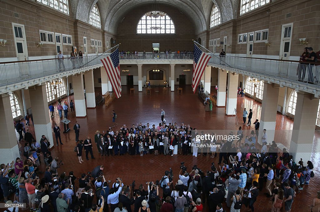 New American citizens pose for photos in the Great Hall on Ellis Island after a naturalization ceremony on May 27, 2016 in New York City. U.S. Secretary of Homeland Security Jeh Johnson administered the oath of citizenship to immigrants from 39 countries on the historic island in New York Harbor where millions of immigrants were processed upon arrival to America. The ceremony, held by U.S. Citizenship and Immigration Services (USCIS), was held in honor of Memorial Day and is one of 100 naturalization ceremonies held in U.S. national parks in celebration of the National Park Service's 100th anniversary.
