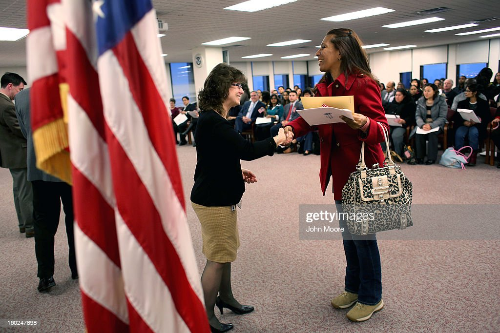 New American citizens receive certificates at a naturalization ceremony at the district office of U.S. Citizenship and Immigration Services (USCIS) on January 28, 2013 in Newark, New Jersey. Some 38,000 immigrants became U.S. citizens at the Newark office alone in 2012.