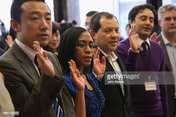New American citizens take the oath of citizenship at a naturalization ceremony on April 9 2013 in New York City Fifteen immigrants from 13 countries...