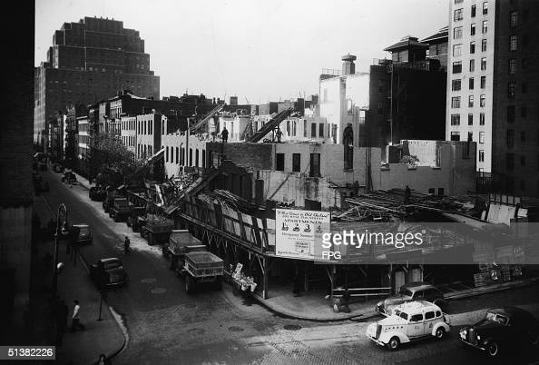 A new apartment building is constructed at the corner of 7th Avenue and 15th Street in the Chelsea Neighborhood New York NY circa 1940