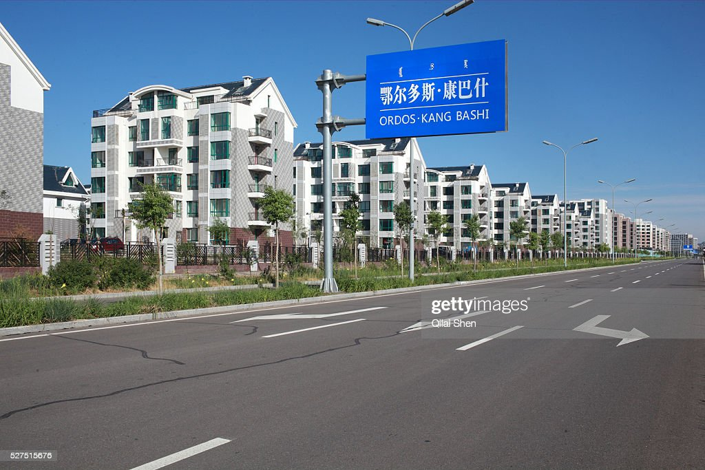 New apartments line an otherwise empty street in Kangbashi New District of Ordos City Inner Mongolia China on 16 August 2011 With an investment of...