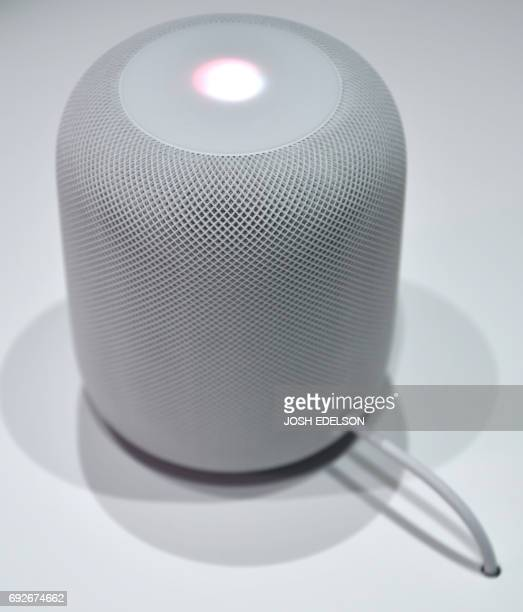 A new Apple HomePod smart speaker is seen on display during Apple's Worldwide Developers Conference in San Jose California on June 05 2017 / AFP...
